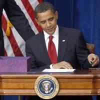 President Barack Obama picks up a pen to sign the economic stimulus bill during a ceremony in the Museum of Nature and Science in Denver, in February 2009. The White House claims that the costly spending bill, signed into law five years ago Monday, was key to America's economic recovery.   AP
