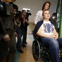 Ukrainian opposition activist Dmytro Bulatov, who was kidnapped an tortured for a week, is seen in a hospital after a press conference Thursday in Vilnius, Lithuania. He has now been appointed youth and sports minister. | AP