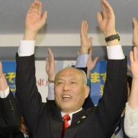Victorious: Ex-health minister Yoichi Masuzoe leads a banzai cheer at his campaign headquarters in Shinjuku on Sunday as exit polls reported that he was set to win the Tokyo gubernatorial election.   KYODO