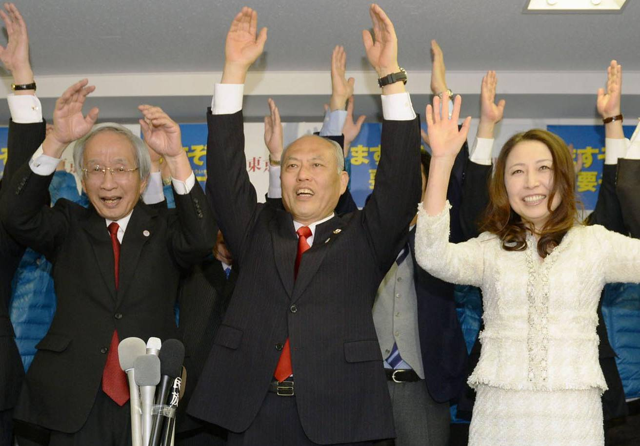Victorious: Ex-health minister Yoichi Masuzoe leads a banzai cheer at his campaign headquarters in Shinjuku on Sunday as exit polls reported that he was set to win the Tokyo gubernatorial election. | KYODO