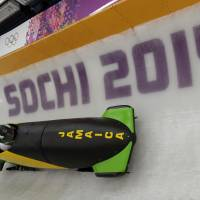 As cool as ever: The Jamaican bobsled takes a turn during a practice run on Thursday in Krasnaya Polyana, Russia. | AP