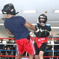 Trading punches: Ryota Murata swings a right hand against Mike Jones in their sparring session at Teiken Gym on Wednesday. | KAZ NAGATSUKA