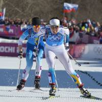 Mission accomplished: Sweden's Charlotte Kalla crosses the finish line, beating Finland's Krista Lahteenmaki in the women's cross-country skiing 4x5km relay in Rosa Khutor, Russia, on Saturday. | AFP-JIJI