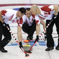 Clean sweep: Canada's E.J. Harnden (center) watches as teammates Ryan Harnden (left) and Ryan Fry sweep during Canada's 11-8 win over Germany on Monday. | AP
