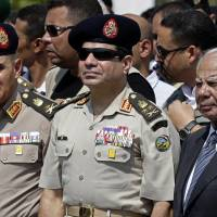 Egypt's military-backed government resigns