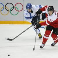 Finland overpowers Austria in hockey opener