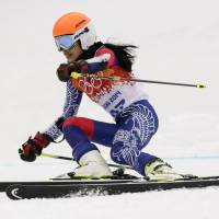First time for everything: Olympic debutant and violinist Vanessa Mae, starting under her father's name as Vanessa Vanakorn for Thailand, skis in the women's giant slalom on Tuesday. | AP