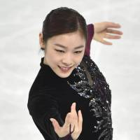 Came up short: Yuna Kim wasn't able to become the third woman to repeat as Olympic singles champion. | AP