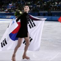 A show of class: Yuna Kim didn't criticize the judges' scores after she received the silver medal. | AP