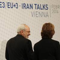 EU foreign policy chief Catherine Ashton (right) and Iran Foreign Minister Javad Mohammad Zarif leave after giving a statement on the last day of the EU 5+1 talks with Iran at the U.N. headquarters in Vienna on Thursday. | AFP-JIJI