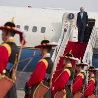 Seoul solution: U.S. Secretary of State John Kerry exits his plane upon arrival at Seoul Air Base on Thursday. Kerry is visiting South Korea, China, Indonesia, and the United Arab Emirates on a seven-day trip. | AP