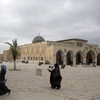 Home of history: Palestinian women walk past the al-Aqsa mosque compound in Jerusalem. | AP