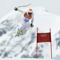 On the move: Bode Miller  makes a jump during men's super combined downhill training in Krasnaya Polyana, Russia on Tuesday. | AP