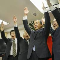 Victory: Nagasaki Gov. Hodo Nakamura celebrates after winning a second four-year term in the gubernatorial election Sunday. | KYODO
