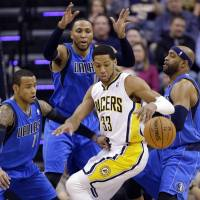 Away it goes: Pacers forward Danny Granger loses control of the ball in front of (from left to right) Mavericks guard Monta Ellis, forward Shawn Marion, and guard Vince Carter during first-half action on Wednesday in Indianapolis. | AP