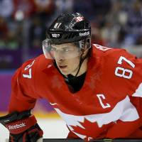 Leader of the pack: Captain Sidney Crosby guided Canada to an Olympic title in Russia. | AP
