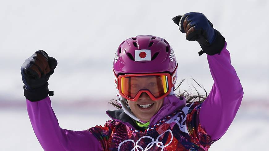 Road to success: A smiling Tomoka Takeuchi won her women's snowboard parallel giant slalom semifinal on Wednesday at Rosa Khutor Extreme Park.