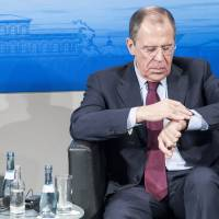 Awkward: Russian Foreign Minister Sergey Lavrov (right) and French Foreign Minister Laurent Fabius attend the Munich Security Conference on Saturday. The annual meeting of the global 'strategic community' was set to deal with thorny international issues, including Ukraine's political turmoil. | AFP-JIJI