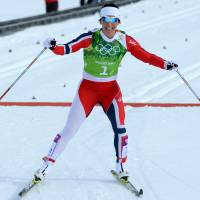 Sucessful result: Norway's Marit Bjoergen crosses the line to win gold in the women's cross-country skiing team sprint classic final on Wednesday.