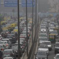 Environmental hazard: Traffic slows to a halt during haze caused by air pollution in New Delhi in January. | BLOOMBERG