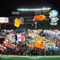 Game's up: Pikachu and Doraemon watch over Next Generation World Hobby Fair.