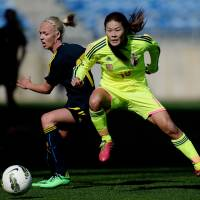 Homare Sawa (right) vies for the ball with Sweden's Caroline Seger during their Algarve Cup match on Monday. Japan won 2-1 and advanced to the final. |  AFP-JIJI