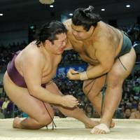 Takayasu (5-8) pulls down Endo (6-7) on Friday, the 13th day of the Spring Grand Sumo Tournament. | KYODO