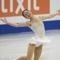 Final performance: Akiko Suzuki takes sixth at the world championships in her last performance before retiring from skating. | KYODO