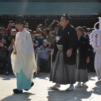 Kakuryu heads into the inner shrine to be presented to the enshrined spirits of the Meiji Emperor and his consort. | MARK BUCKTON