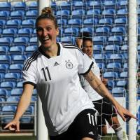 Anja Mittag celebrates after scoring the second goal for Germany during the Algarve Cup final on Wednesday.  | AP