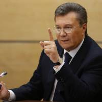 Ukraine's fugitive President Viktor Yanukovych gives a news conference in Rostov-on-Don, his first public appearance since fleeing his country. | AP