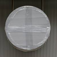 A covered Bitcoin sign is hung outside a bitcoin cafe which was scheduled to open in March at the building housing the company operating the Mt. Gox Bitcoin exchange in Tokyo. | Bloomberg