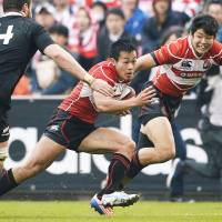 Game of two halves: Japan may have emerged as a winner in the history stakes against New Zealand but has yet to win on the field.   KYODO