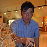 Museum curator Kunitsugu Yokoyama demonstrates ancient farming techniques. | WINIFRED BIRD