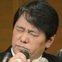 Mamoru Samuragochi holds a news conference at a Tokyo hotel Friday, his first public appearance since he admitted he used a ghostwriter for his classical music pieces.   KYODO