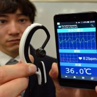 Tiny 17-gram ear computer tested in Tokyo