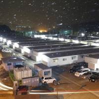Temporary dwellings are seen Sunday night in the city of Kamaishi, Iwate Prefecture. | KYODO