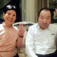 Freed death row inmate Iwao Hakamada and his sister Hideko pose for photos at a Tokyo hotel Thursday night. | KYODO