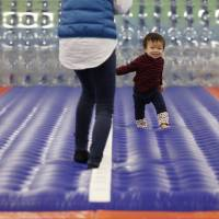 Daichi Toyota, 1, plays with his mother Feb. 27 at an indoor playground that was built for children and parents who refrain from playing outside because of concerns about radioactive fallout in Koriyama, Fukushima Prefecture. | REUTERS