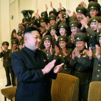 North Korean leader Kim Jong Un claps during the first contest of the Korean People's Army art squads at an undisclosed place and date in this official photo released Wednesday.   AFP-JIJI