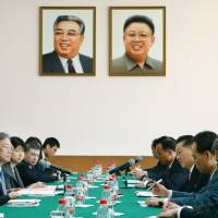 Negotiators from Japan (left) and North Korea kick off two days of director general-level talks at the North Korean Embassy in Beijing on Sunday. | KYODO