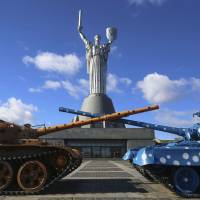 The 100-meter sword-wielding statue of 'The Motherland' is seen at the National Museum of the History of the Great Patriotic War in Kiev on Monday, the same day Russian President Vladimir Putin recognized Ukraine's Crimean Peninsula as an 'independent and sovereign country.' | REUTERS