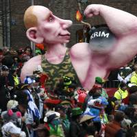 A carnival float with a papier-mache caricature of Russian President Vladimir Putin flexing his muscle, with the word 'Crimea' written on it, takes part in the traditional Rose Monday carnival parade in the western German city of Duesseldorf on Monday.   REUTERS