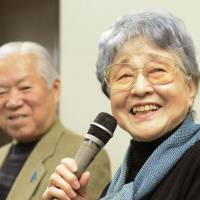 Sakie Yokota speaks to the media Monday in Kawasaki as her husband, Shigeru, looks on. | KYODO