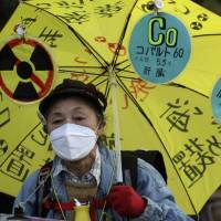 Not fooling around: An anti-nuclear protester marches toward the Diet as part of a demonstration in Tokyo on Dec. 22.   AP
