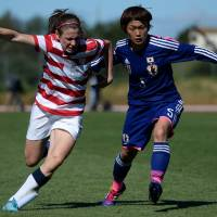 The chase is on: U.S. midfielder Heather O'Reilly (left) and Japan defender Aya Sameshima vie for the ball during an Algarve Cup match on Wednesday in Parchal, Portugal. | AFP-JIJI