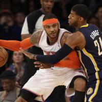 New era: New York's Carmelo Anthony shields the ball from Indiana's Paul George during the Knicks' 92-86 win on Wednesday. | AP