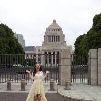 Brush with politics: TV personality Haruka Christine stands outside the Diet building in Tokyo's Nagata-cho district.