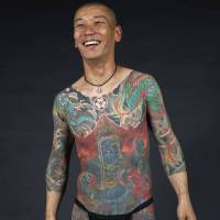 Inked: Kip Fulbeck's life-size photos of irezumi, such as this full-body suit tattooed by Shige, will be displayed at the 'Perseverance' exhibition in Los Angeles. | KIP FULBECK