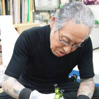 Master at work: Horiyoshi III works at his studio in Yokohama. | JON MITCHELL